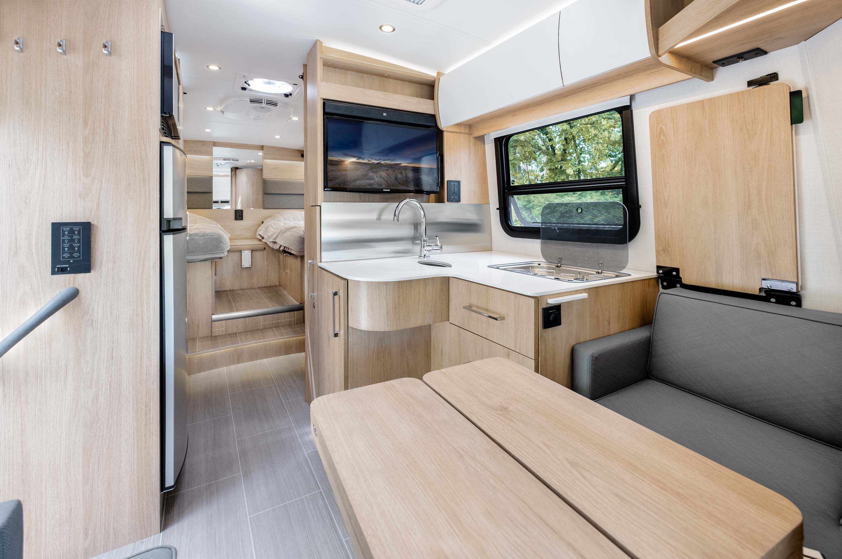 Introducing The Wonder Rear Twin Bed With Revolutionary Exterior Garage Leisure Travel Vans