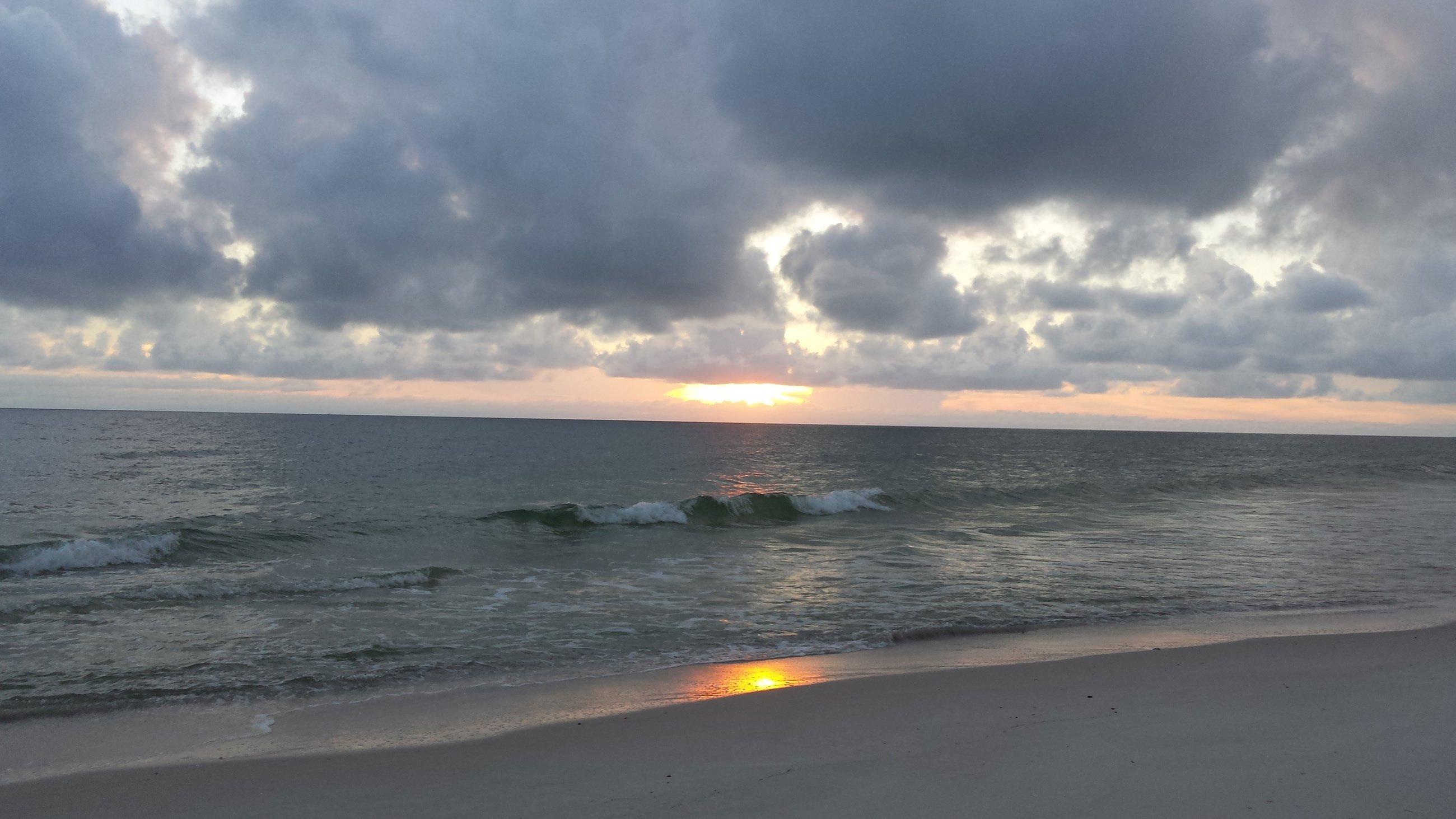 overcast beach with sun reflection