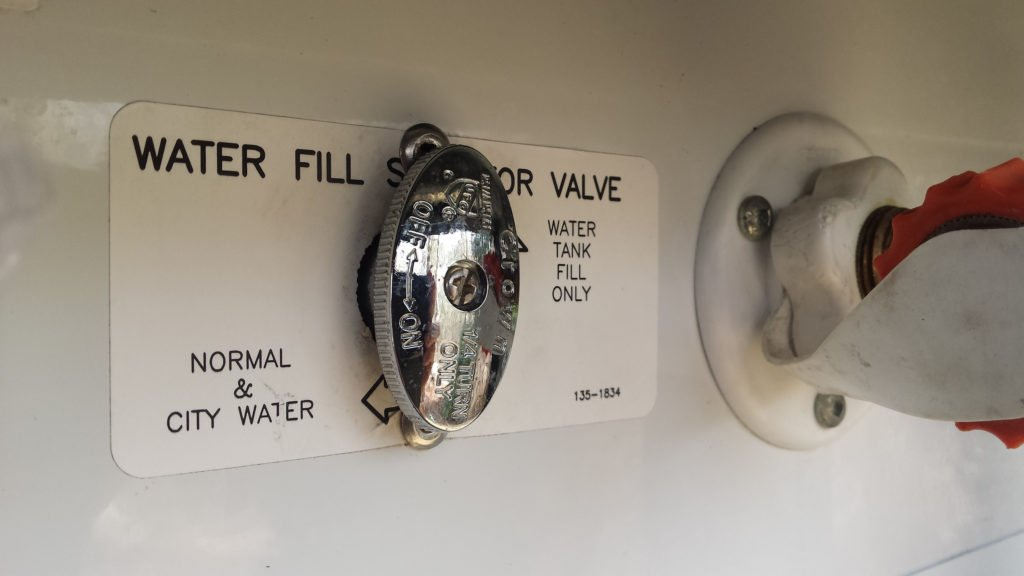 city water valve in an rv service bay