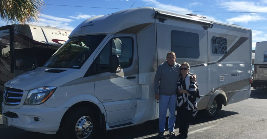 Couple standing in front of RV